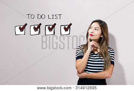 To Do List With Young Businesswoman In A Thoughtful Face