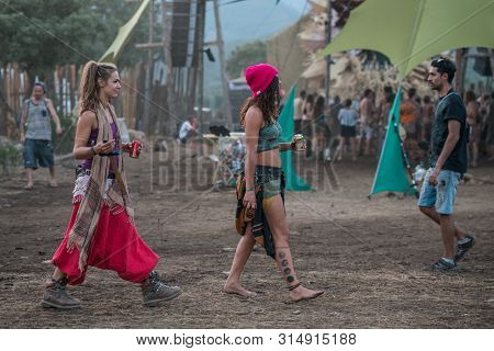 Riomalo De Abajo, Extremadura, Spain - July 13, 2018: Two Girls Walks Near The Main Stage Of The Los
