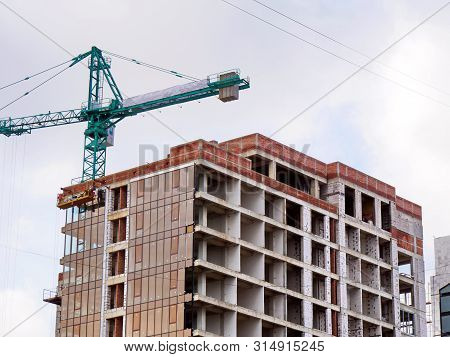 Construction Site With Crane And Building. Skyscraper Construction.