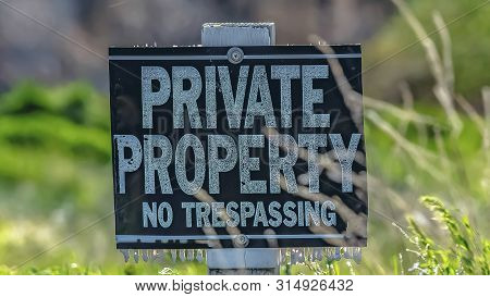 Panorama Frame Close Up Of A Private Property No Trespassing Sign On A Sunny Day