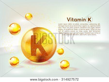 Vitamin K gold shining icon. Ascorbic acid. Shining golden substance drop. Nutrition skin care. Vector. poster