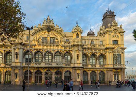 Barcelona, Spain- 10 November 2014: View Of The Facade Edifici Port Building In Barcelona. Historica