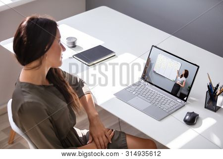 Woman Leaning New Skill Online. Watching Video Tutorial