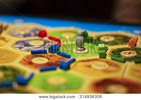 Kharkiv, Ukraine - Jan 05 2018: The Settlers Of Catan, Ongoing Multiplayer Board Game. Settlements A
