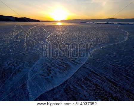 Sunset Scene Of Lake Baikal In Winter; Shoot Photo From Ice Surface That Formation From Lake Water T