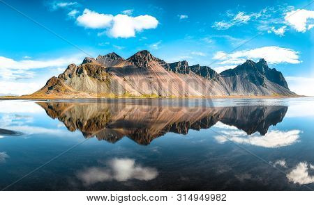 Splendid Sunny Day And Gorgeous Reflection Of Vestrahorn Mountaine On Stokksnes Cape In Iceland. Loc