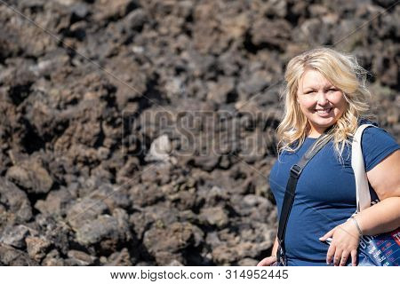 Woman Hiker Poses On The Trail To Lava Butte On The Trail Of Molten Lands In Newberry National Volca