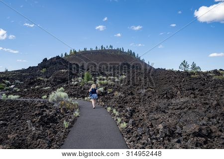 Cute Woman Takes A Hike Along The Trail Of Molten Lands In Lava Lands Newberry Volcano National Monu