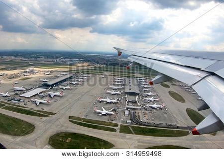 London, UK - 20th May 2019: London Heathrow Terminal 5,  the home of British Airways. Looking down on the runways and bays of BA planes. Strike action may cause them to be grounded during summer 2019.