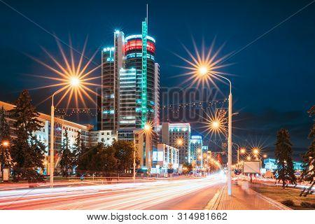 Minsk, Belarus. Night Traffic On Illuminated Street Pobediteley Avenue In Minsk.