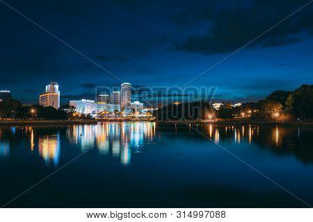 Minsk, Belarus - September 3, 2016: Pobediteley Avenue In Summer Evening, Night Lights Illumination.
