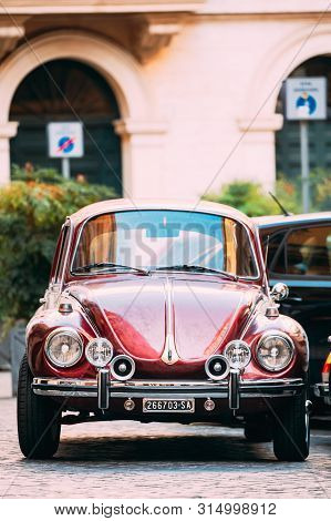 Rome, Italy - October 20, 2018: Old Retro Vintage Red Color Volkswagen Beetle Car Parked At Street.