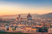 Sunset view of Florence cityscape with Santa Maria del Fiore Duomo, Cathedral landmark. Firenze rooftops with beautiful light. European tourism panorama background poster