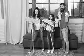 Cleaning day. Family mom dad and daughter with cleaning supplies at living room. We love cleanliness and tidiness. Cleaning together easier and more fun. Family care about cleanliness. Start cleaning. poster