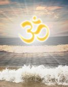 Hindu religious symbol om or aum against sun shine in the background and waves from the ocean in the foreground poster