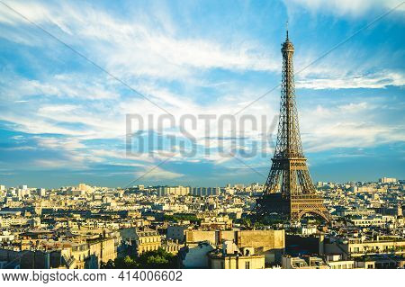 Skyline Of Paris With Eiffel Tower In France At Dusk