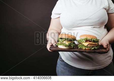 Obese Woman With Two Tasty Fattening Hamburgers