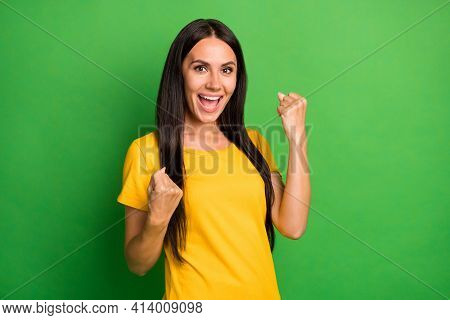 Photo Of Charming Happy Young Woman Raise Fists Win Wear Yellow T-shirt Isolated On Bright Green Col