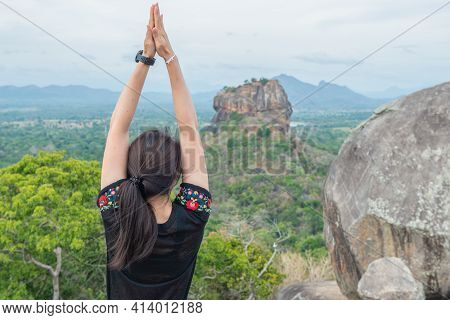 Cropped Shot View Of Young Woman Doing Yoga On Top Of Pidurangala Rock And Looking To Sigiriya Rock