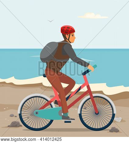 Guy In Bicycle Helmet On Bike. Male Character With Tourist Backpack Rides On Beach In Autumn