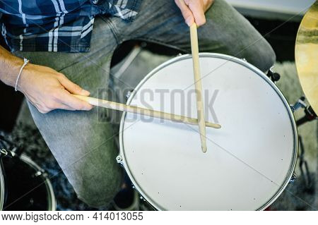 Close Up Of A Man Playing Drums In A Recording Studio, Top View.enjoying Music