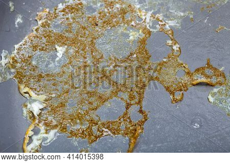 Burnt Crust Of Fried Eggs In A Ceramic Frying Pan With Polytetrafluoroethylene Non-stick Coating Clo