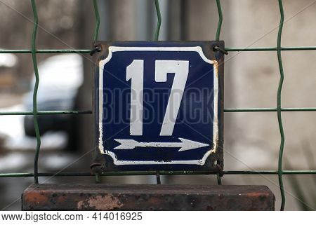 Weathered Grunge Square Metal Enamelled Plate Of Number Of Street Address With Number 17