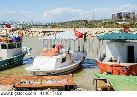 Manavgat, Turkey, 03.16.2021 - Turkish Fishing Boats Are Moored In The Sea Bay. Fishing Boats With A