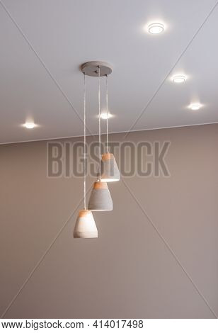 Stylish Kitchen Interior With Beautiful Lamps On The Ceiling