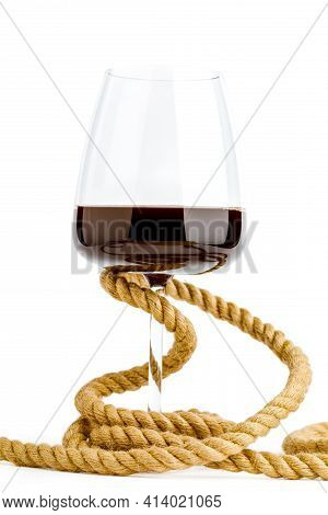 The Wine Glass Is Tied With A Rope. The Concept Of Alcohol Dependence.