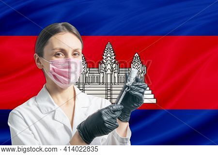 Girl Doctor Prepares Vaccination Against The Background Of The Cambodia Flag. Vaccination Concept Ca