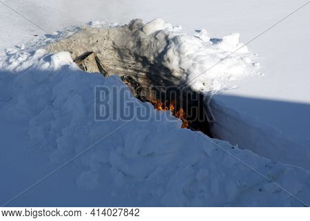 Burning Trash In The Snow. Bonfire In A Snowdrift. A Place For Incineration Of Household Waste In Th