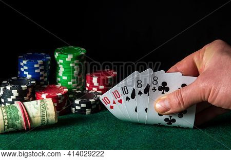 Poker Cards With Full House Or Full Boat Combination. Close-up Of A Gambler Hand Is Holding Playing