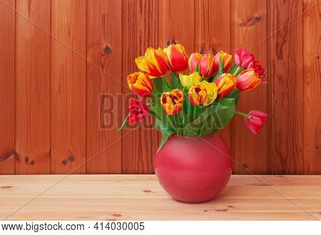 Bouquet Of Fresh Colorful Tulips In Vase On Wooden Table. View With Copy Space.