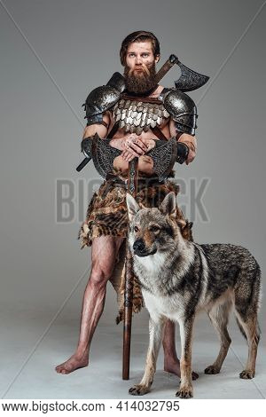 Grimy Barbaric Viking With Nude Body Posing With Beautiful Wolf