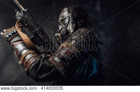 Grimy Hunter With Gas Mask And Custom Gun In Dark Background