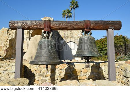 SAN JUAN CAPISTRANO, CA - DECEMBER 12, 2017: Original Mission Bells. The two bells hang where they would have within the bell tower of the Great Stone Church.