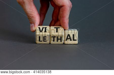Vital Vs Lethal Symbol. Businessman Turns Wooden Cubes And Changes The Word 'lethal' To 'vital'. Bea