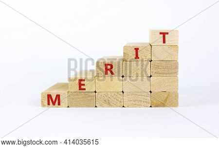 Merit Symbol. Wooden Blocks With The Word 'merit'. Beautiful White Background, Copy Space. Business
