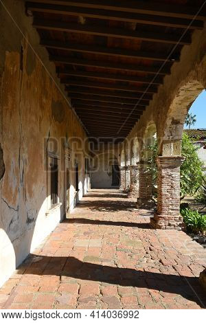 San Juan Capistrano, Ca - December 1, 2017: Walkway and arches at the San Juan Capistrano Mission in Souther California.