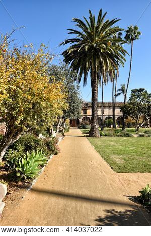 SAN JUAN CAPISTRANO, CALIFORNIA - 12 JAN 2017: Path in the Central Courtyard of the Historic Mission in Southern California.