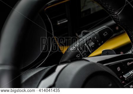 Car Rain Windscreen Wiper Control Switch In Car Close Up View On The Steering Wheel. Wipers Switch C