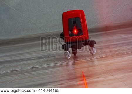 Laser Level At Work. Laser Level Wall And Floor. Apartment Renovation Concept, Level Markup