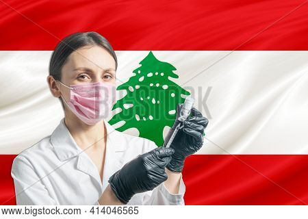 Girl Doctor Prepares Vaccination Against The Background Of The Lebanon Flag. Vaccination Concept Leb