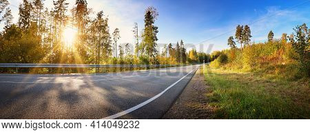 Asphalt Road Panorama In Countryside On Sunset In Summer.