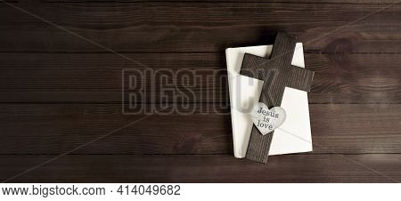 Closed Books Holy Bible. Scripture. Cross Of Jesus. Heart. Jesus Is Love. On A Wooden Background