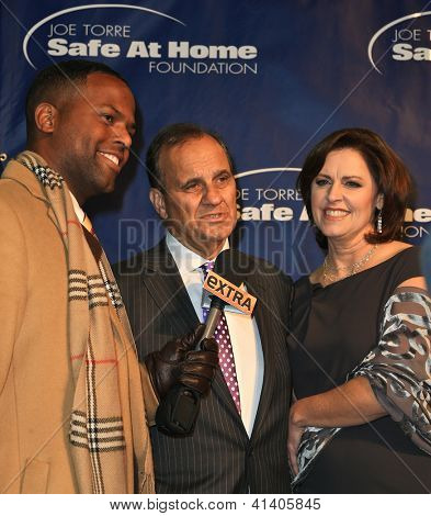 NEW YORK-JAN 24: Extra host AJ Calloway (L) with Joe Torre and wife Ali,Dashow at the 10th Anniversary Joe Torre Safe At Home Foundation Gala at Chelsea Piers on January 24, 2013 in New York City.