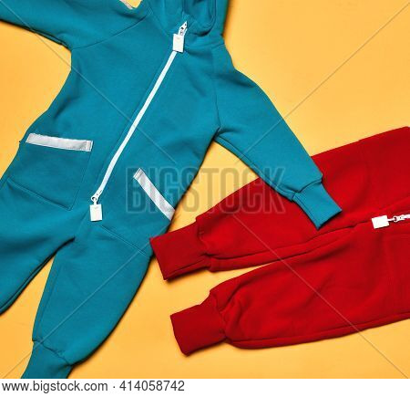 Fabric Children Fleece Colored Tracksuit, Bodysuit Store Assortment. Sport Outfit. Kids Garment. Fas