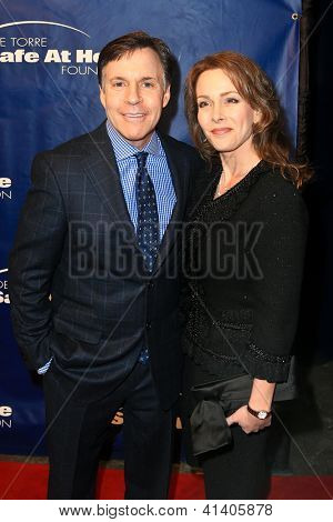 NEW YORK-JAN 24: Bob Costas and wife Jill attend the 10th Anniversary Joe Torre Safe At Home® Foundation Gala at Pier 60, Chelsea Piers on January 24, 2013 in New York City.
