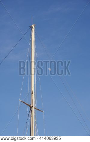 The Yacht's Mast Against The Blue Sky With The Moon With Space For Text.